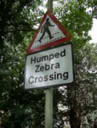 Hump back road Zebra sign