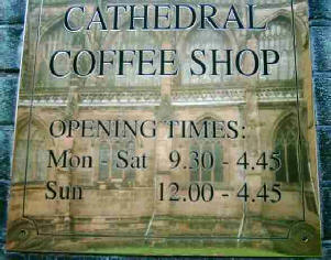 Cathedral coffee shop sign in brass with cathedral reflected in it