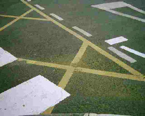 Many signs painted on the road surface at a crossing