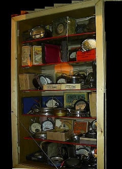 A cabinet of old radio meters