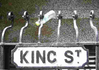 King Street road sign with litter.