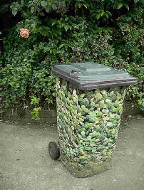 A wheely bin with floral  design
