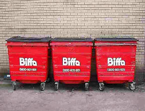 Three red refuse bins in a line