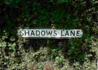 Lane sign reading Shadow lLne.